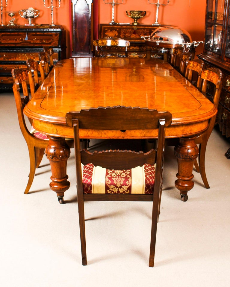 There is no mistaking the style and sophisticated design of this fabulous dining set comprising a rare English antique Victorian pollard oak extending dining table, circa 1850 in date and a set of ten contemporary dining chairs.  The styles that