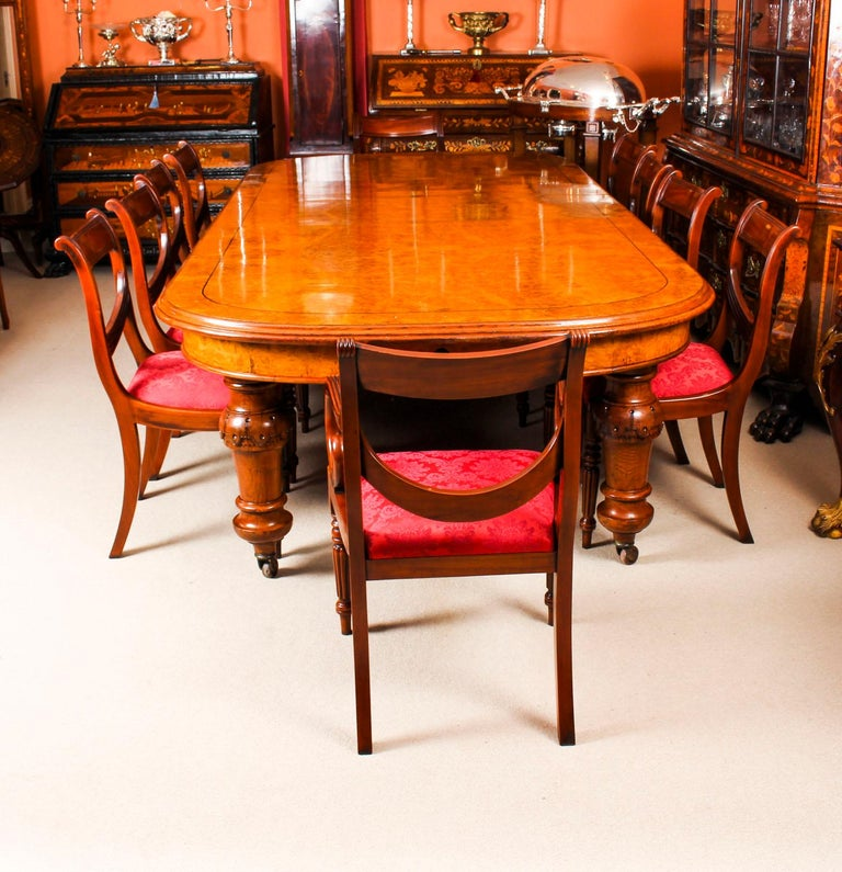 There is no mistaking the style and sophisticated design of this exquisite dining set comprising a rare English antique Victorian pollard oak extending dining table, circa 1850 in date and a set of ten vintage dining chairs.