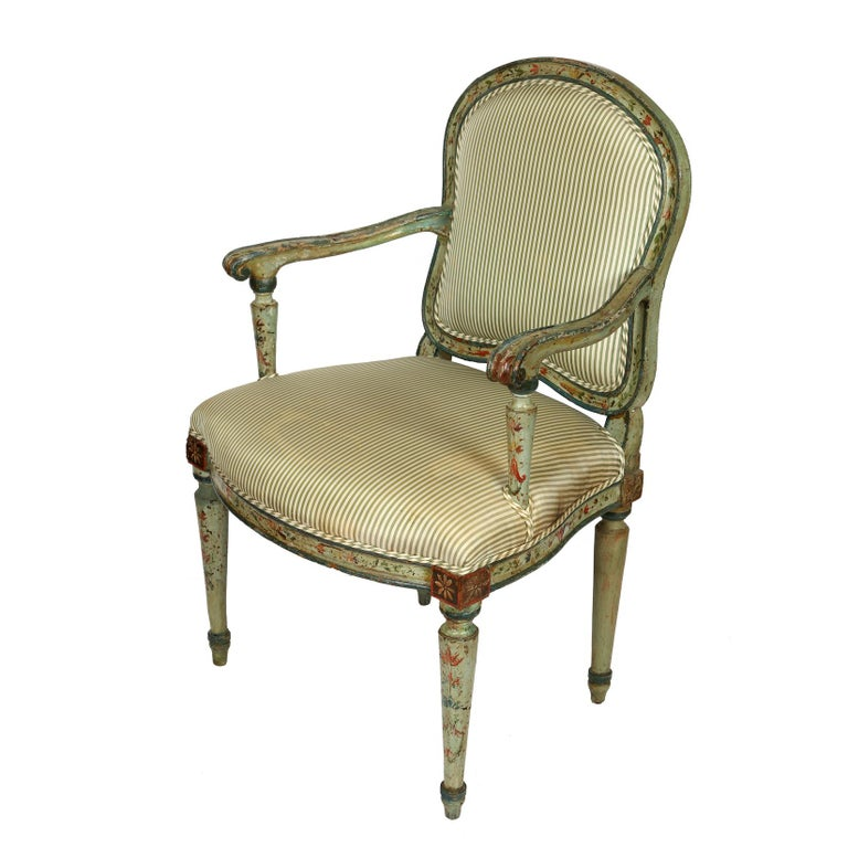 Lovely antique polychrome armchair in green silk ticking stripe fabric on seat and back. Beautiful painted floral detail to arms, legs and frame.