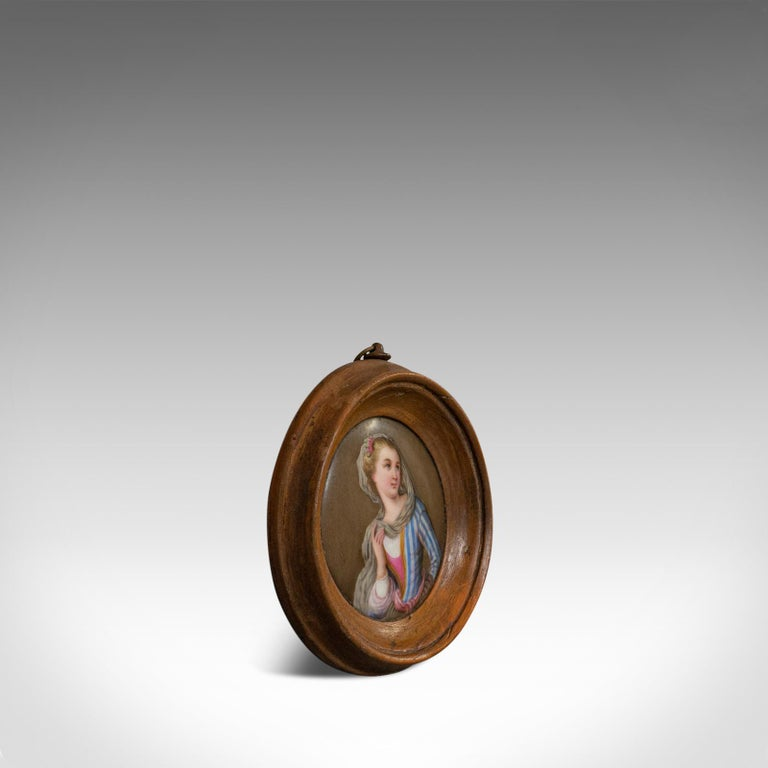 This is an antique porcelain plaque. An English, walnut and ceramic decorative female portrait and dating to the Victorian period, circa 1890.