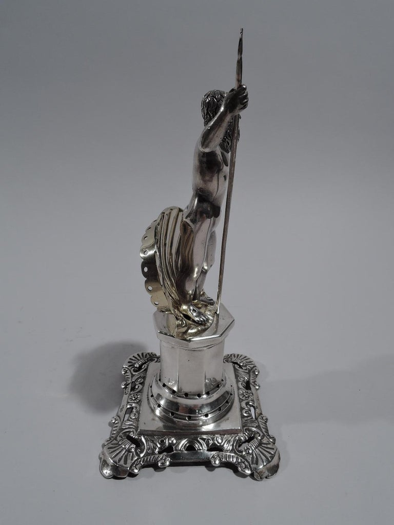 Portuguese neoclassical silver toothpick holder. A cast figure of trident-wielding Neptune stands in front of gilt scallop shell; both mounted to faceted pedestal with stepped base, which is pierced for inserting toothpicks. Foot has tooled flowers