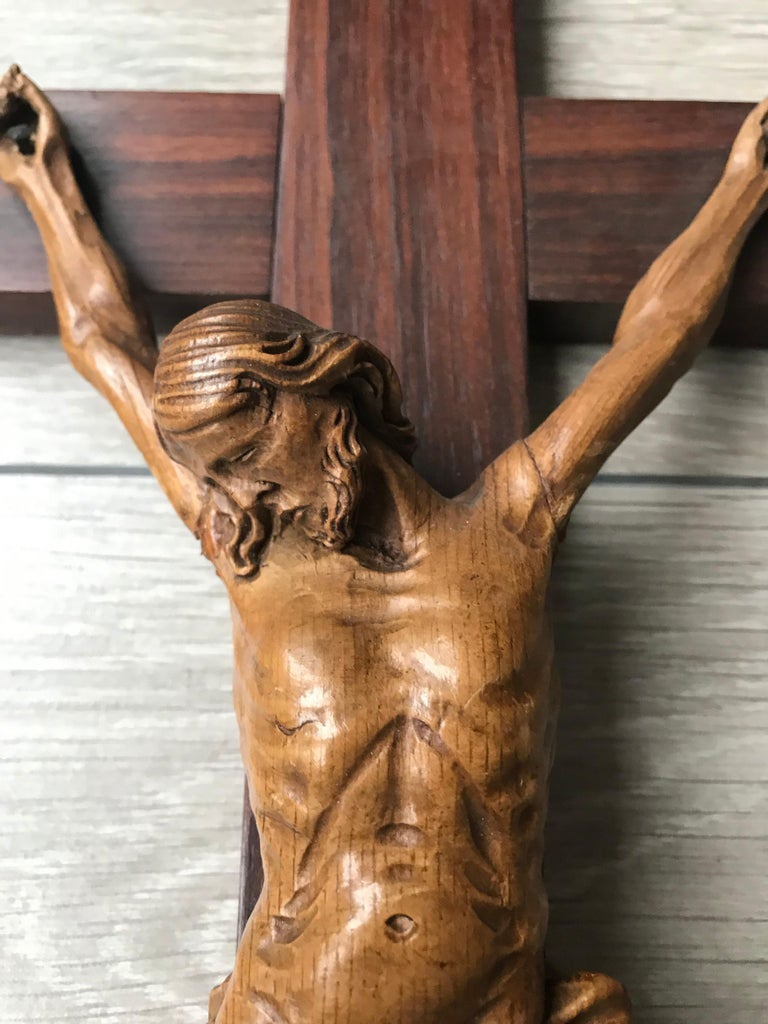 Another finely detailed, early 1900s wooden cross with a carved corpus of Christ.  This sacred and religious work of art is a hand-carved out of fruitwood Christ mounted on an macassar cross and this fine and detailed example is in excellent