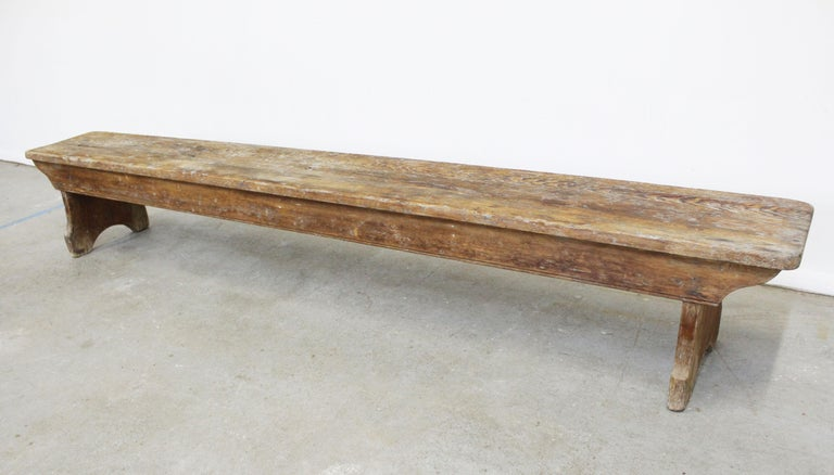 Offered is an antique 19th century Primitive, elongated bench. It is in very good condition considering its age, showing normal wear (age wear, surface scratches/chips, stains). It is structurally sound. It is not signed.   Dimensions: 94