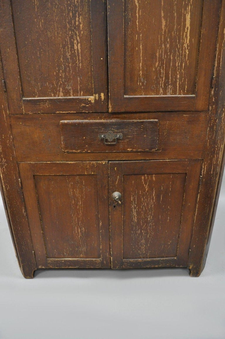 Antique primitive rustic brown distressed painted corner cupboard cabinet in distressed condition for sale in philadelphia