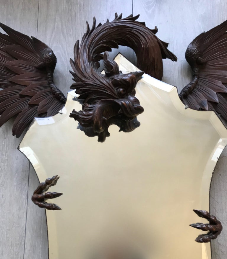 French Antique & Quality Carved Dragon Sculpture Holding a Shield Shaped Beveled Mirror For Sale