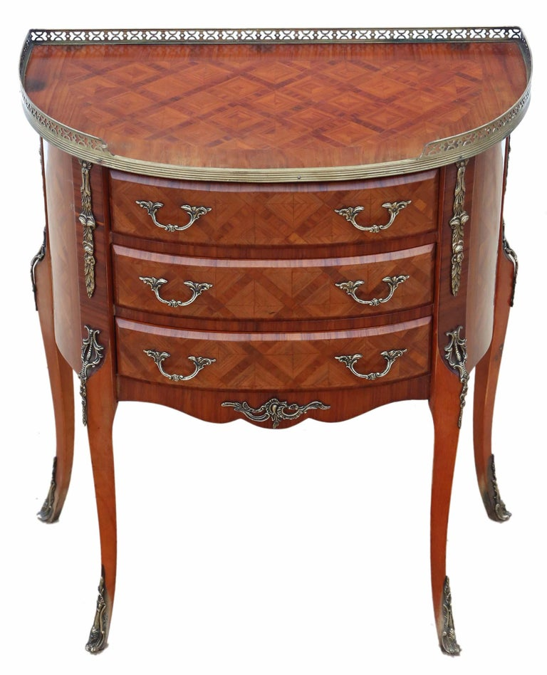 Antique quality large French inlaid parquetry bedside table or cupboard.  No loose joints and no woodworm. Full of age, character and charm. Attractive demilune shape, parquetry inlays, brass ormolu mounts and gallery. The mahogany lined drawers