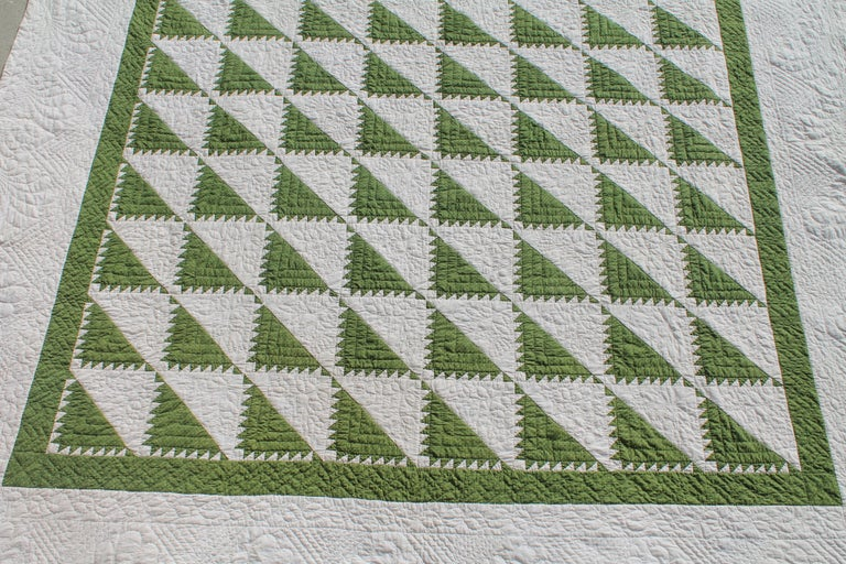 This amazing king size 19th century green and white delectable mountain pattern quilt is in pristine condition. The finest of quilting and piece work. This quilt is quite unusual size and condition.