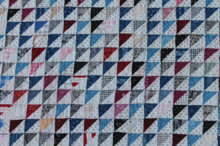 Antique mini pieced triangles quilt in good condition and amazing piecework as well. The backing is in a plain simple printed fabric. This is a real collectors quilt.