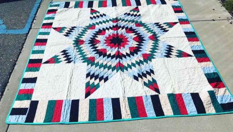 This folky five color star quilt is in fine condition and has a roman striped border. The piece work is very good with nice tight stitching. This is a pristine quilt and has never been used or washed. No stains or damages. Found in Texas.
