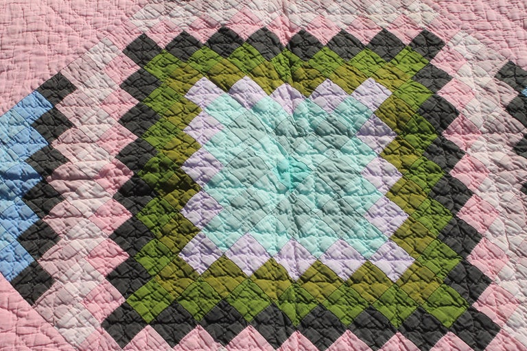 This beautiful 1930s Amish Quilt is in pristine condition. The contained diamond is in the sunshine and shadow design and color. Great color and great condition. The Border is pristine. This one patch pattern in the diamond is most unusual.