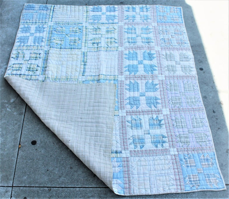 Antique quilt in blue bear paw pattern. This fine faded blue and grey comfy quilt is on the thicker side. The condition is very good.