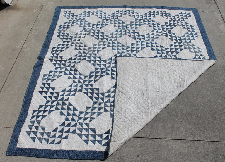 19th century blue and white ocean waves quilt in pristine condition. The white is a black and white calico print fabric. This quilt is from Pennsylvania and is a large generous size. The piecing and quilting are fantastic and it is a summer weight