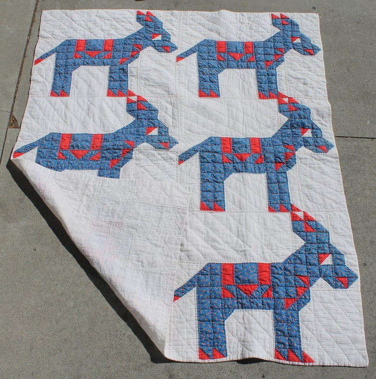 This folky red, white and blue donkey quilt is in good condition and is a rare pattern to find.