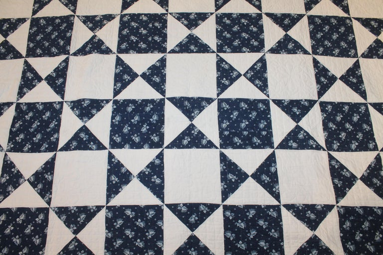 This fine super early large 19th century blue resist fabric eight point star quilt is in pristine condition. It is most unusual with a fringe added at the time of construction of the quilt. It is a large queen or king size quilt.
