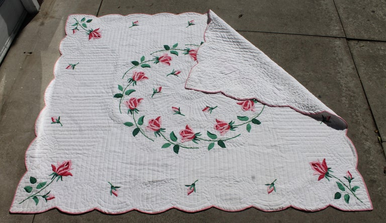 Beautiful handmade rose applique quilt in amazing condition. Stellar pattern and great stitching The binding is in great condition. Professionally cleaned.