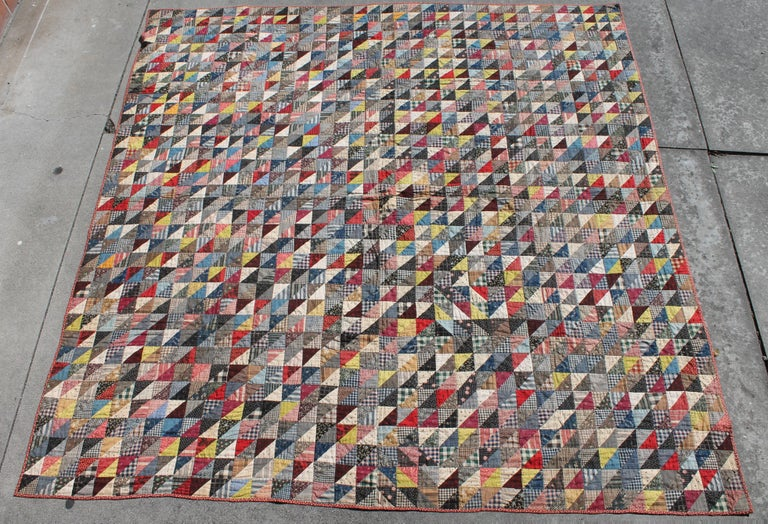 This 19th century quilt is mini pieced triangles, birds in flight quilt was found in Berks County, Pennsylvania and is in pristine condition. Multi calico fabrics both front and back.