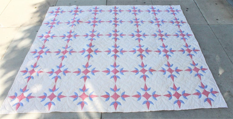This fun red, white and blue geometric quilt is in fine condition and a very good size. Will fit a queen or king bed.