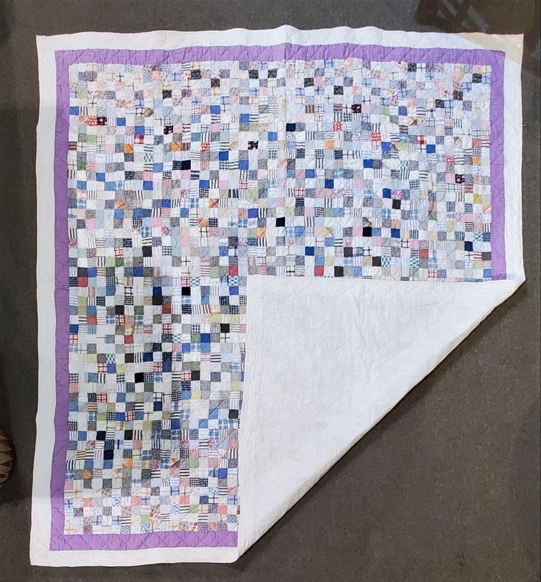 This fine quilt looks like a painting. Its multi pieces are all a collage of many different fabrics. The condition is very good and it has been prof. laundered.