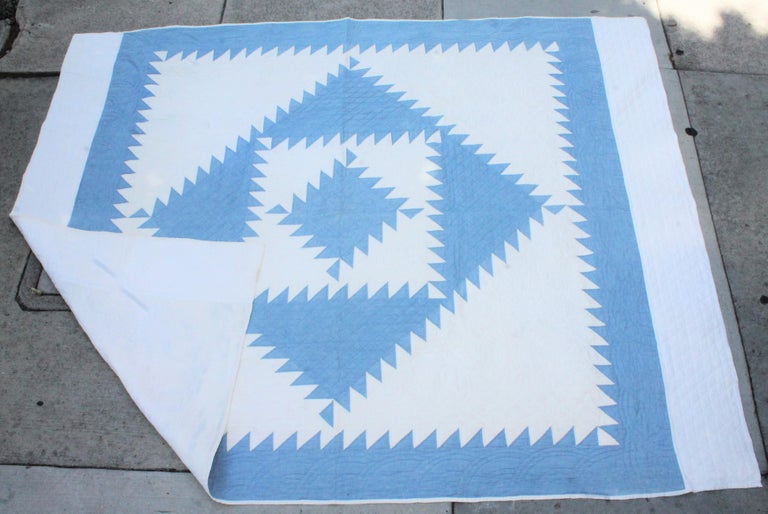 This masterpiece quilt has amazing quilting and piece work. It is a shambrea blue fabric on a white ground. Fantastic workmanship. This was found and probably made in Lancaster County, Pennsylvania.