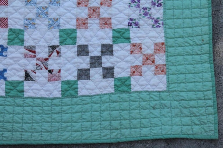 This fine tiny pieced postage stamp chain quilt is in pristine condition. This quilt is from the 1930s and made from old calico dress prints.