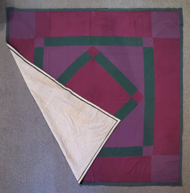 this fine Amish diamond in a square is from Lancaster County, Pennsylvania and is in pristine condition and is all wool. This finely quilted and pieced quilt is a perfect example of perfection of Pennsylvania Amish quilts. These early 1920's Amish