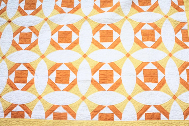 This finely pieced and quilted yellow and white quilt is in fine condition. There is also shades or rust in areas as well. Very nice quilting.