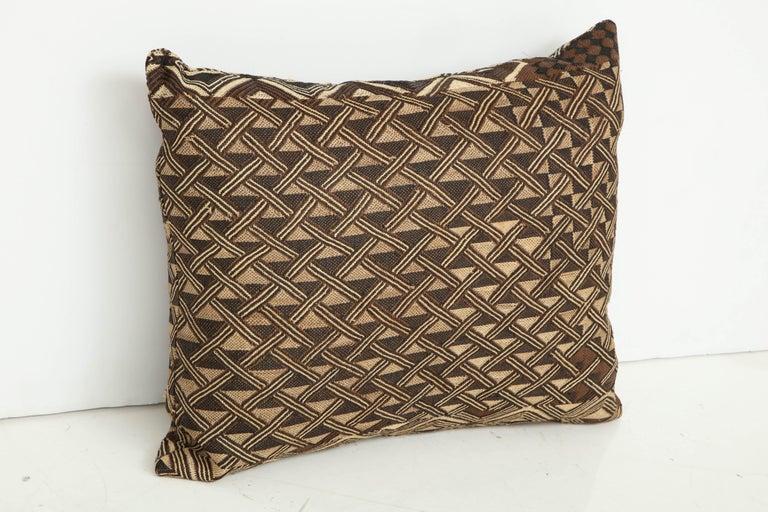 Antique Raffia Kuba cloth pillow, beige and brown pattern.