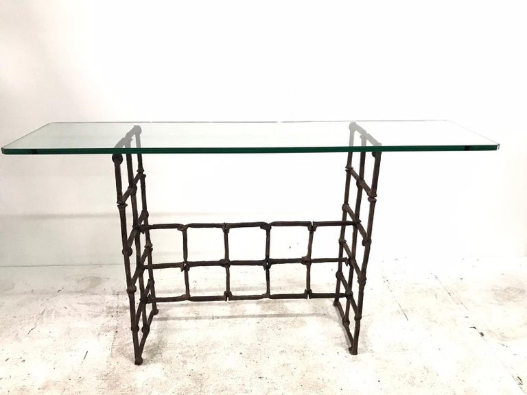 Comprised of antique rail road spikes, this narrow console with glass top is a rare find. Base only dimensions 35