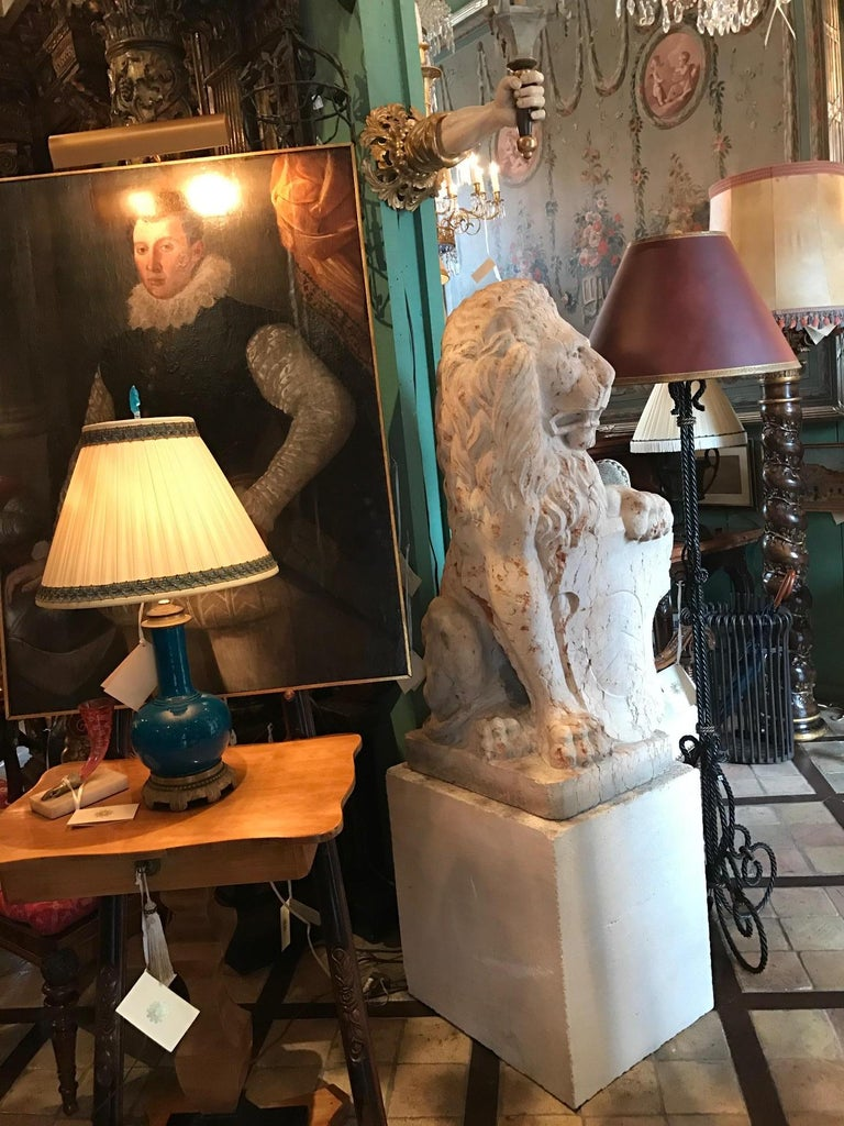 Rare large pair of early 18th century carved marble terracotta Figures of regal lions, holding an impalement escutcheon A heraldic marshaling denoting a union Continental or florence Each of these fine, impressive sculptures  exhibit impressive