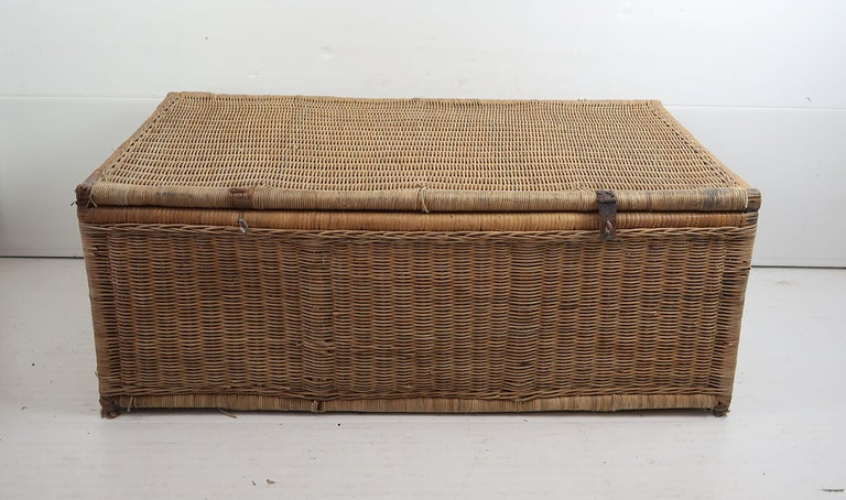 Great rattan travelling trunk.  Lovely color.  It had been originally covered in painted canvas cover. It gives us the provenance.  Wear and tear consistent with age and use  Traces of grey paint in a few places particularly the
