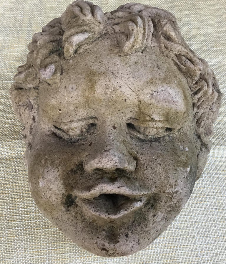 Exceptional large cherub head made of hand carved sand stone, beautiful facial expression, this piece waste used as wall-mounted fountains head, or could be use as table decoration if mounted on a Base. Base is not included.