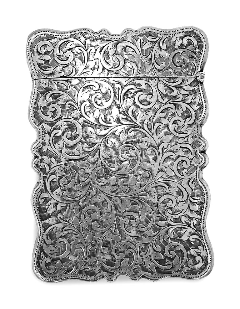 Antique rectangle cigarette box all hand engraved beautifully and delicately .This gorgeous and unique box is made in England and is sterling silver 0.925 proof. There are different signs of lion and anchor is on the box and has a date  1907  on the