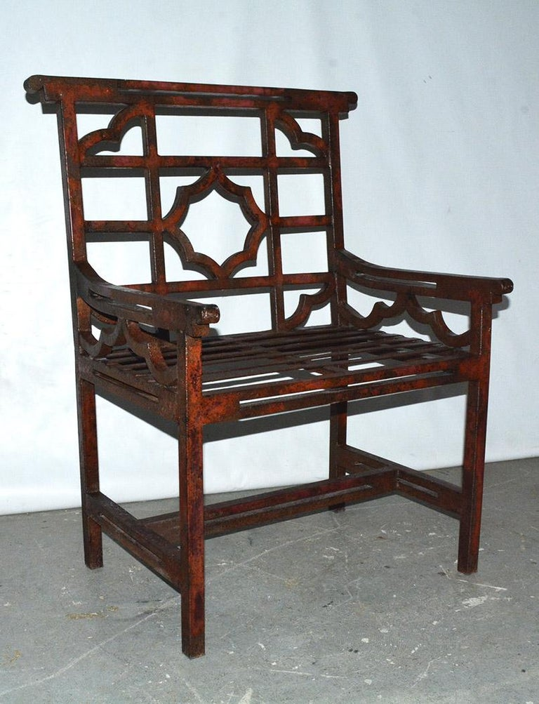 """Highly stylish, classical form of a English garden chair, sometimes referred to as """"chinoiserie"""" style, but also known in Britain as """"cockspen"""" chairs. This chair is large and commodious. The garden/patio chair still have evidence of red paint, the"""