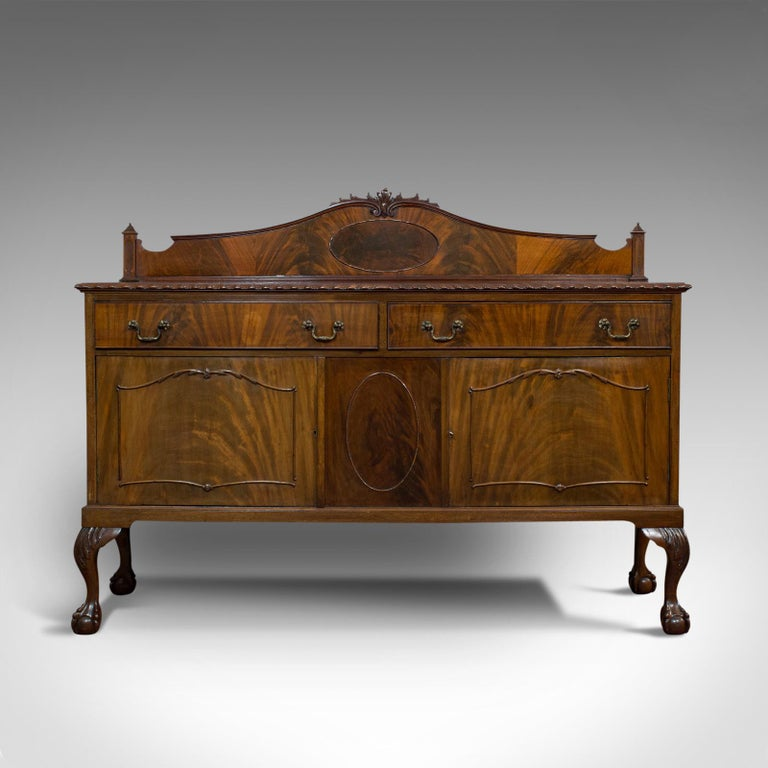 This is an antique Regency revival sideboard. An English, flame mahogany dresser cabinet, dating to the late Victorian period, circa 1900.  Quality piece of furniture with Regency revival taste Displays a desirable aged patina — light sun