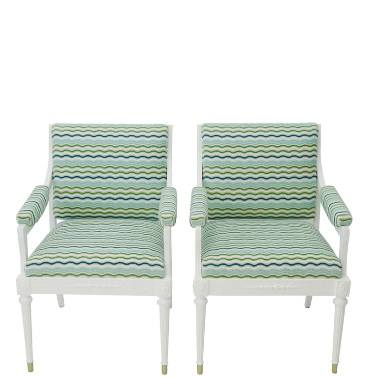 This pair of vintage Hollywood Regency style armchairs are newly upholstered in bright turquoise, aqua, green and white zigzag velvet