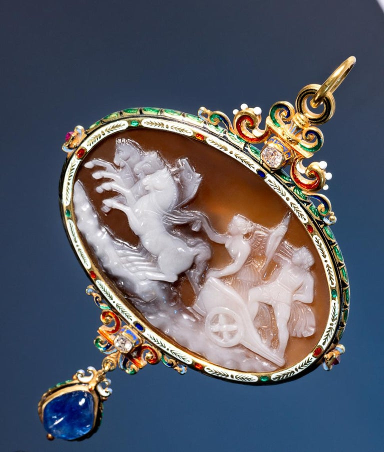 BERNARDO ANTICHITÀ PONTE VECCHIO FLORENCE The large  hardstone cameo carved to depict Nike, the Victory driving the chariot with Jupiter, within a frame decorated with multicolored enamels accented by two rubies at the sides,  at the top an enamel