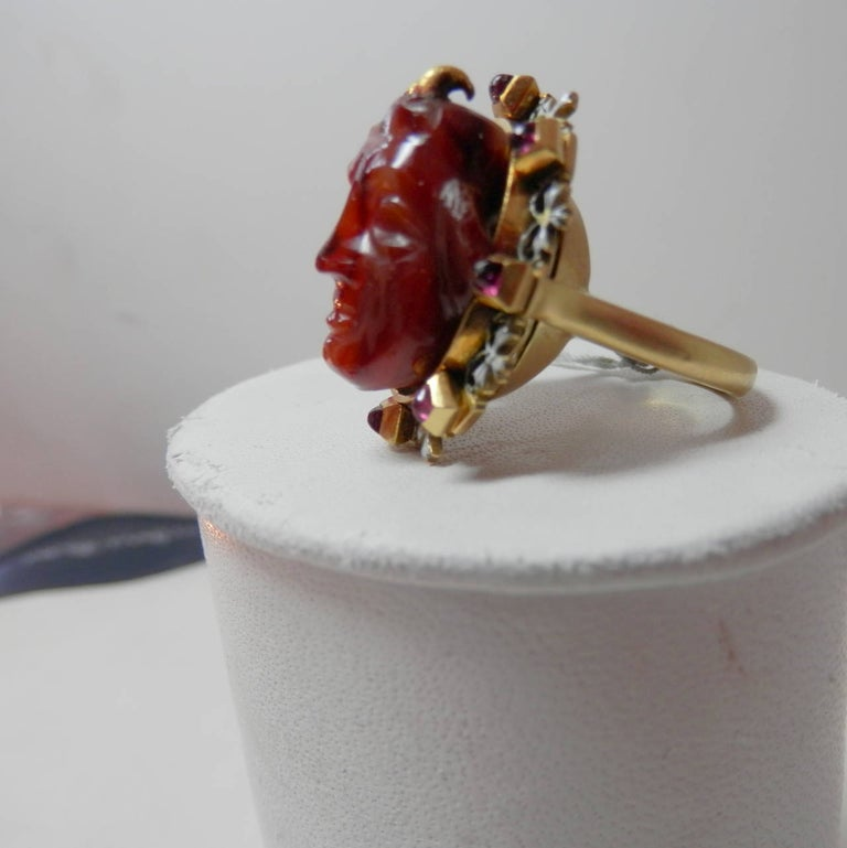 Holbeinesque Antique Ring of a Fine Carving Surrounded with Rubies and Enamel For Sale