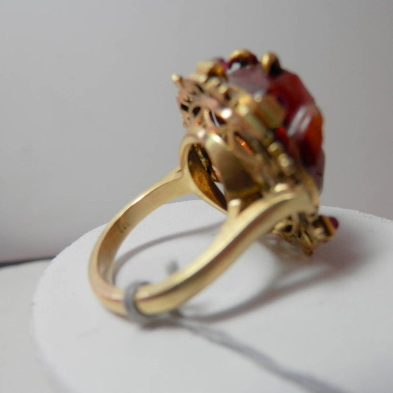 Antique Ring of a Fine Carving Surrounded with Rubies and Enamel In Good Condition For Sale In Aspen, CO