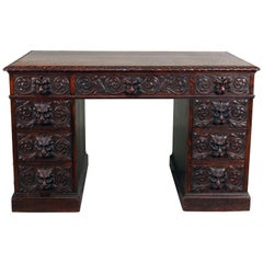 Antique RJ Horner School Figural Carved Oak Knee Hole Campaign Desk, circa 1910