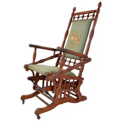 Antique Rocking Chair Hand Carved and Turned Walnut Wood Needlepoint Upholstery