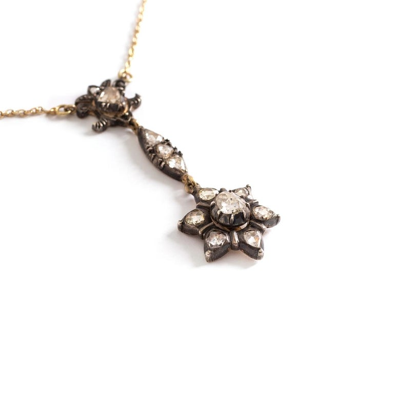 Antique Rose cut Diamond on Silver and Gold Chain Necklace. Pendant representing a Star. Pendant length: 4.50 centimeters. Star's diameter: approximately 16.24 millimeters. Central rose cut Diameter diameter: 5.60 millimeters. Chain necklace length: