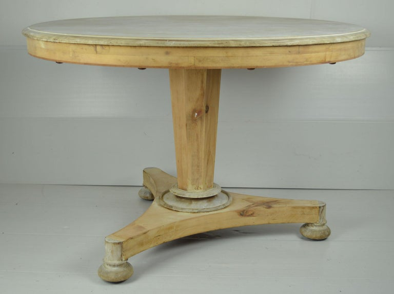 Fabulous small round table. Made from bleached Honduras mahogany and pine  I particularly like the simplicity of this table .  Beautifully figured top.   On the original castors.   I have chosen not to lacquer or wax the table.