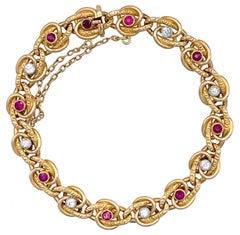 Antique Ruby Diamond 18 Karat Gold Platinum French Eternity Knots Link Bracelet