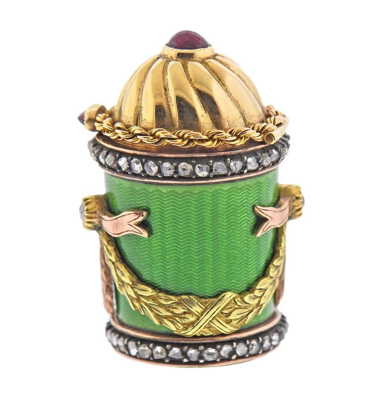Antique Rusian maker mark 18k gold and silver pill box, decorated with green guilloche enamel, rubies and rose cut diamonds. Box measures 1.25