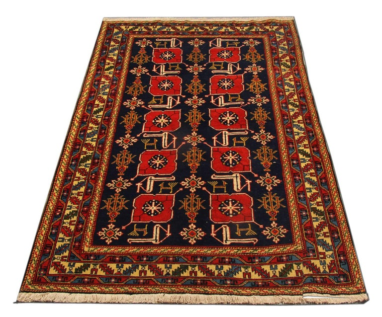 This red rug is a rare antique Caucasian designed Armenian Karabagh. This tribal rug is a one-of-a-kind treasure in the weaving world. The geometric rug design name is Karaghashli. Luxury rugs as this antique piece of art would complement give