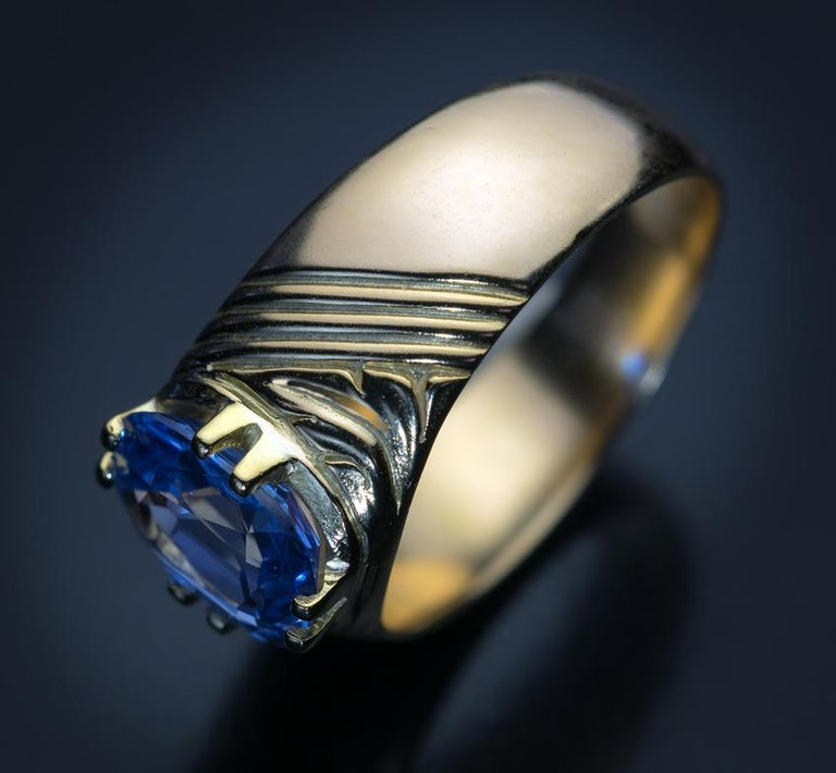 Made in Moscow between 1908 and 1917.  An antique Russian 14K gold unisex ring is set with a 2.50 ct cushion cut natural sapphire of a sky blue color and excellent clarity. The sapphire measures 9.26 x 7.28 x 3.74 mm.  The ring is marked with 56