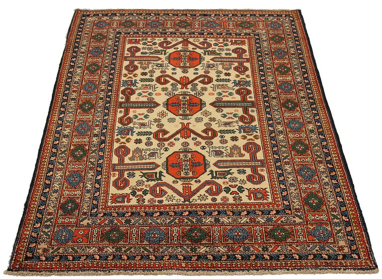 Antique Russian area rug handwoven from the finest sheep's wool. It's colored with all-natural vegetable dyes that are safe for humans and pets. It's a traditional Azarbaijan design handwoven by expert artisans. It's a lovely area rug that can be