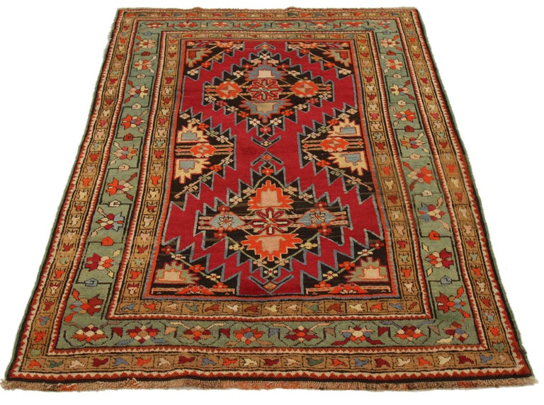 Antique Russian area rug handwoven from the finest sheep's wool. It's colored with all-natural vegetable dyes that are safe for humans and pets. It's a traditional Gharebagh design handwoven by expert artisans. It's a lovely area rug that can be