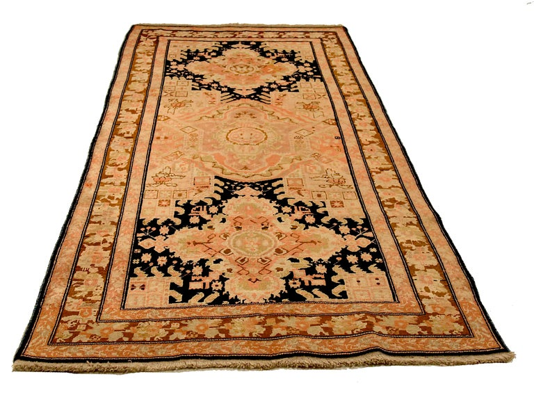 Antique Russian area rug handwoven from the finest sheep's wool. It's colored with all-natural vegetable dyes that are safe for humans and pets. It's a traditional Karebagh design handwoven by expert artisans. It's a lovely area rug that can be