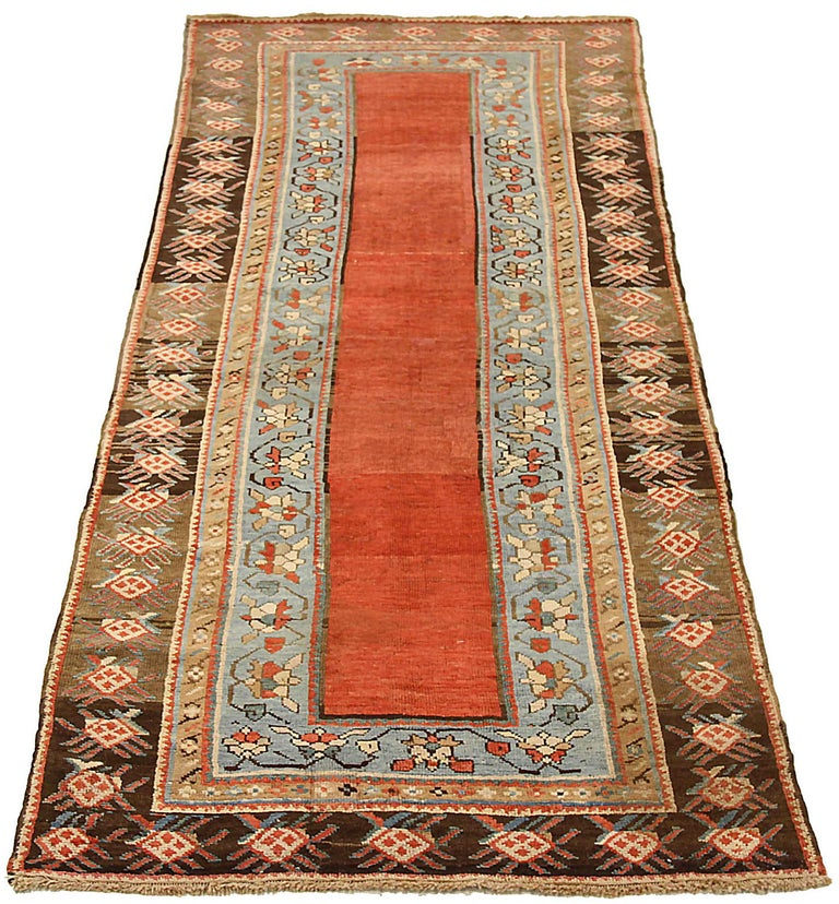 Antique Russian area rug handwoven from the finest sheep's wool. It's colored with all-natural vegetable dyes that are safe for humans and pets. It's a traditional Kazak design handwoven by expert artisans. It's a lovely area rug that can be